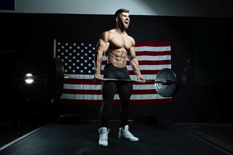 Jake Burton RaveRunner and IFBB Pro Lifting weights